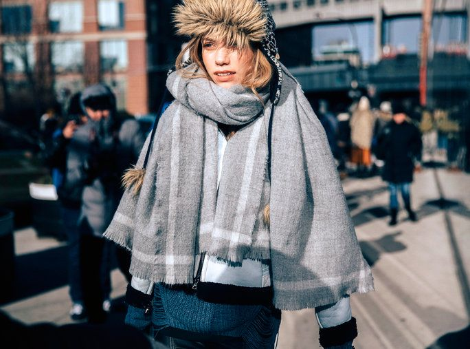 Modello Laura Schellenberg exits the Tibi show at Skylight 60 Tenth in a fur cap and a wool/cashmere scarf with frayed edges during New York Fashion Week: Women's Fall/Winter 2016 on February 13, 2016 in New York City. (Photo by Melodie Jeng/Getty Images)