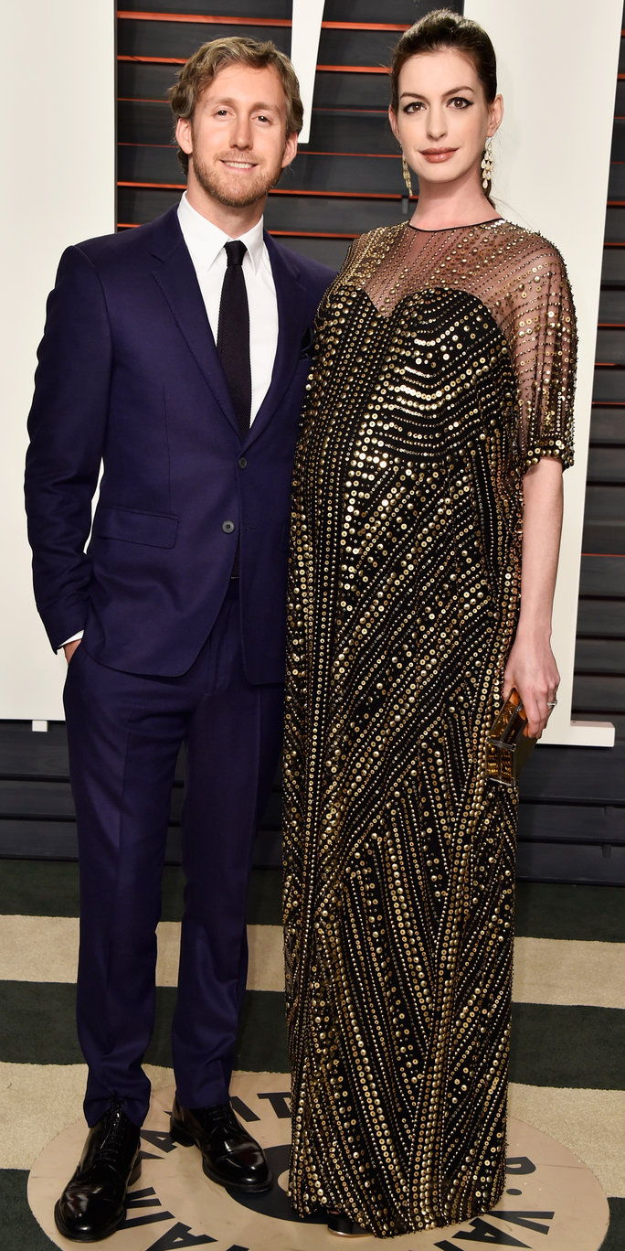Actors Adam Shulman (L) and Anne Hathaway attends the 2016 Vanity Fair Oscar Party Hosted By Graydon Carter at the Wallis Annenberg Center for the Performing Arts on February 28, 2016 in Beverly Hills, California.