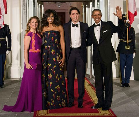 NOI President Barack Obama (R), Canadian Prime Minister Justin Trudeau (2nd R) and their wives Michelle Obama (2nd L) and Sophie Gregoire Trudeau (L) pose u[pon the Trudeau's arrival for a State Dinner in their honor at the White House in Washington, DC, o