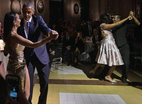 AS President Barack Obama (L) and First Lady Michelle Obama (2nd R) dance tango with dancers during a state dinner at the Kirchner Cultural Centre in Buenos Aires on March 23, 2016. The United States and Argentina sealed a major trade deal on the eve -the