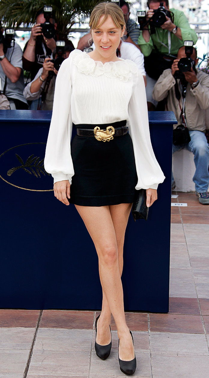 In an Oscar de la Renta top and a Lana Marks belt at the Cannes Film Festival, 2007