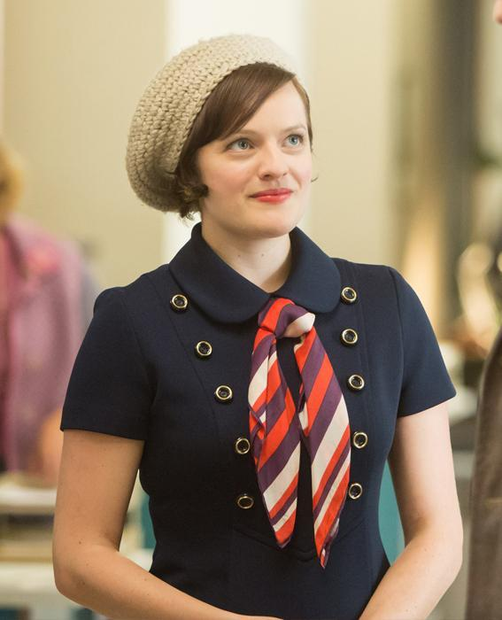 Elisabeth Moss as Peggy Olson in Mad Men wearing navy dress and hat