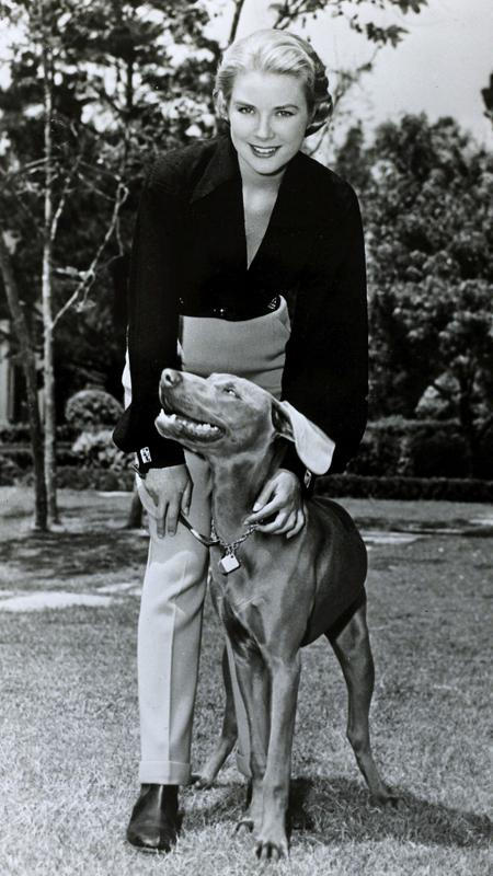 Januari 1956, American actress Grace Kelly, pictured with her dog