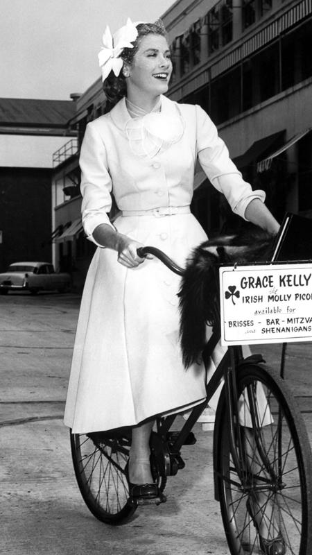 Grace Kelly bicycles to the soundstage of her latest Paramount picture, 1954