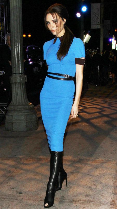 Vittoria Beckham in blue dress with black trim and open-toe black boots