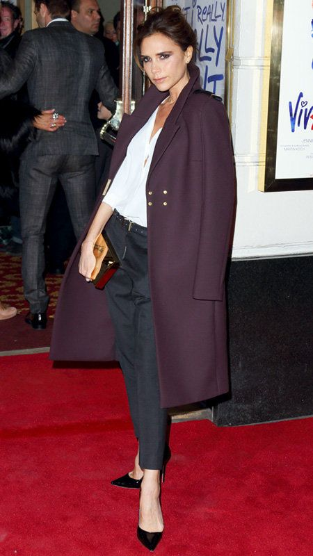 Vittoria Beckham with navy pants, white button down, and plum coat