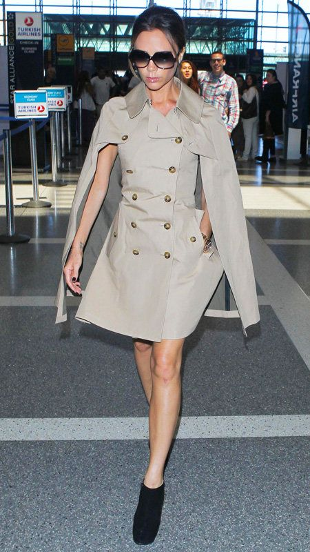 Vittoria Beckham wearing tan double button trench cape coat