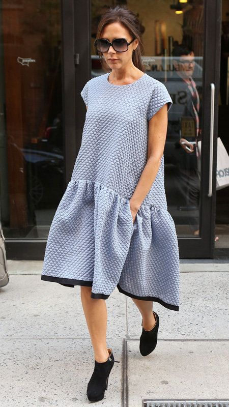 Vittoria Beckham in light blue oversized dress and black booties