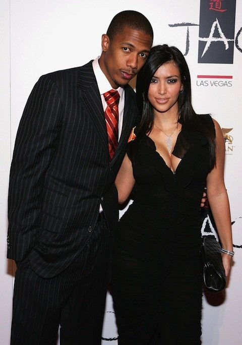 LAS VEGAS - SEPTEMBER 30: Actor Nick Cannon (L) and Kim Kardashian arrive at the Tao Nightclub at the Venetian Resort Hotel Casino during the club's one-year anniversary party on September 30, 2006 in Las Vegas, Nevada. (Photo by Ethan Miller/Getty Imag
