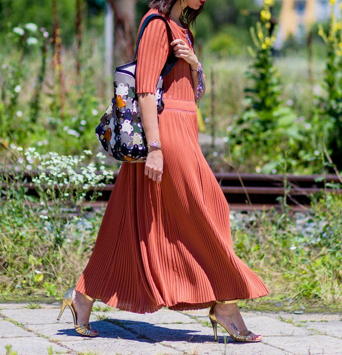 MILANO, ITALY - JUNE 20: Natasha Goldenberg wearing a maxi dress and bucket bag outside Gucci during the Milan Men's Fashion Week Spring/Summer 2017 on June 20, 2016 in Milan, Italy. (Photo by Christian Vierig/Getty Images) *** Local Caption *** Natasha Go