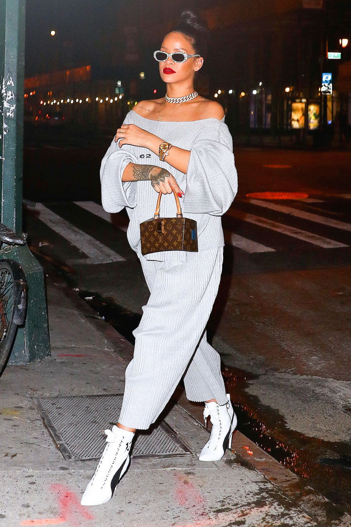 Un off-the-shoulder sweatsuit is instantly sexy paired with stilettos.