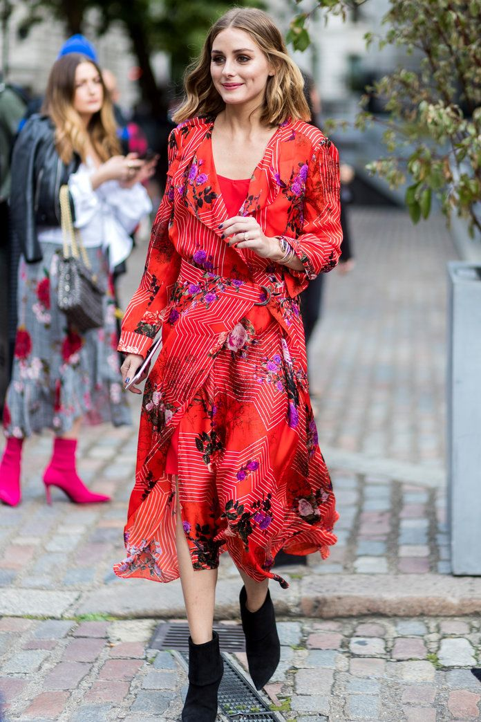 olivia Palermo wearing red dress outside Preen during London Fashion Week September 2017 on September 17, 2017 in London, England.
