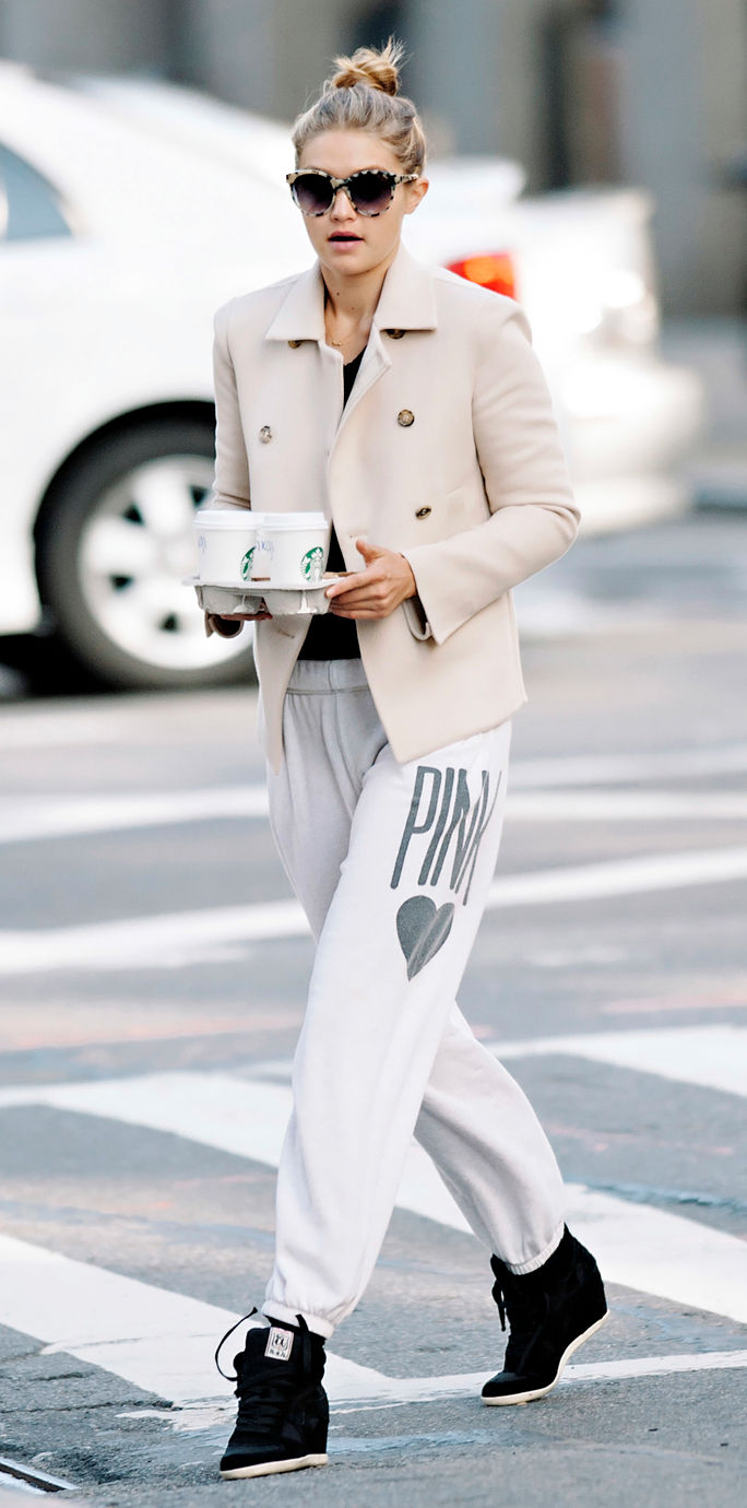 Gigi Hadid seen wearing white blazer and sweatpants while making a coffee run in NYC