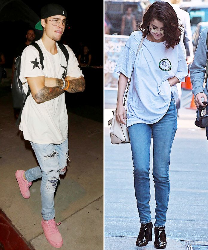 In white graphic tees and jeans