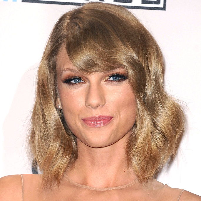 Taylor Swift poses in the press room at the 2014 American Music Awards at Nokia Theatre L.A. Live on November 23, 2014 in Los Angeles, California.